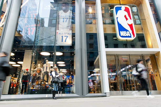 New York, February 21, 2017: People standing and walking by the front window of the NBA store in Manhattan.